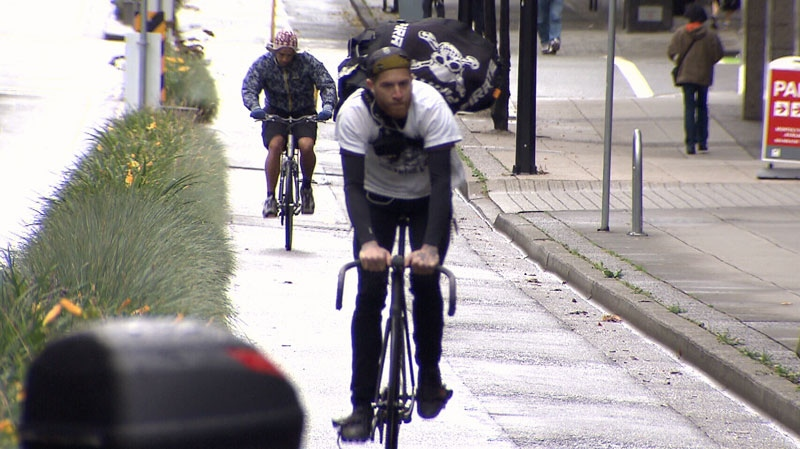 A cyclist utilizes a separated bike lane in downtown Vancouver. Oct. 24, 2012. (CTV)