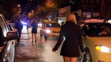 Nightclub and bar patrons leaving the Granville Street entertainment district venture out into Seymour Street to flag down taxis. (CTV)