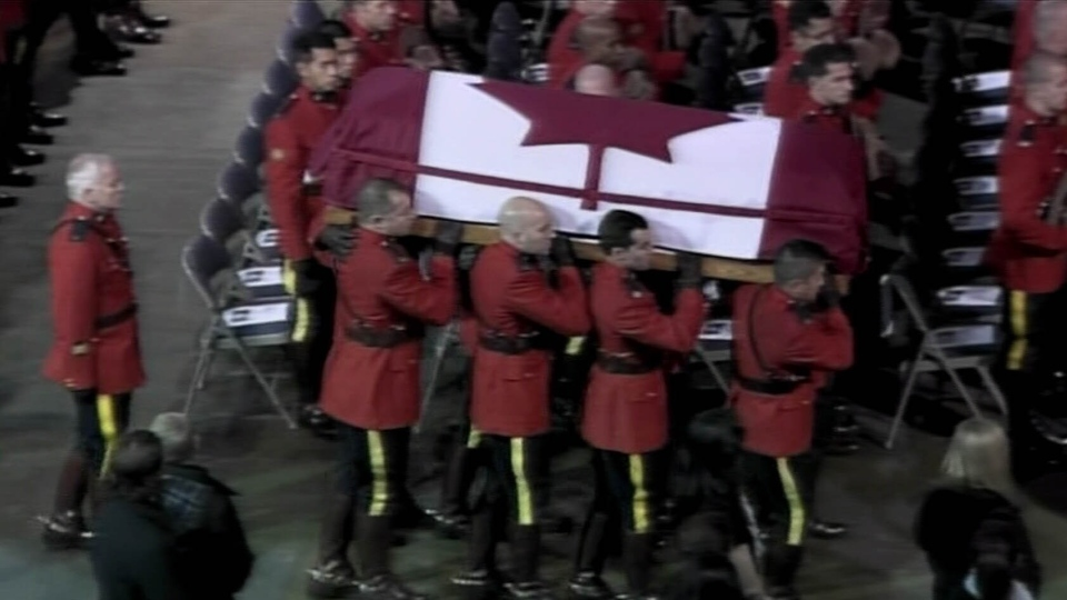 Mounties carry in the body of Const. Adrian Oliver during his funeral on Nov. 20, 2012. (CTV)