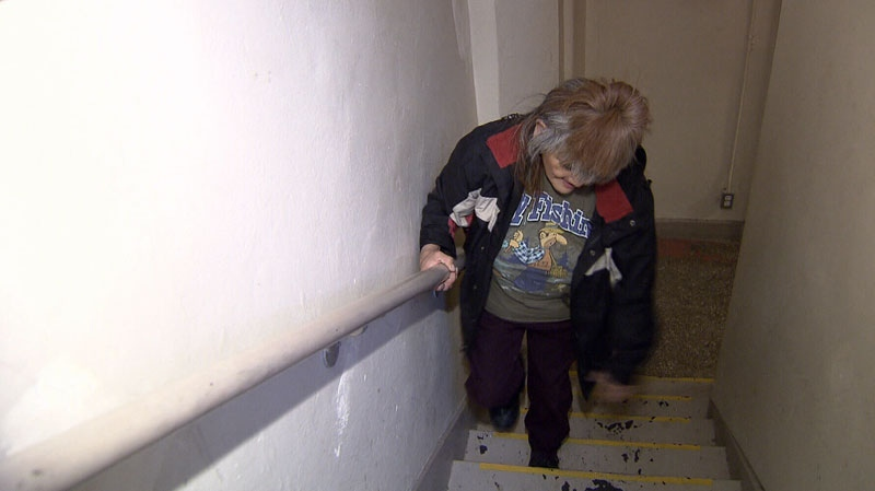 Delores Williams climbs the stairs to get to her unit at the single-room occupancy Hutchinson Block building. Nov. 21, 2012. (CTV)