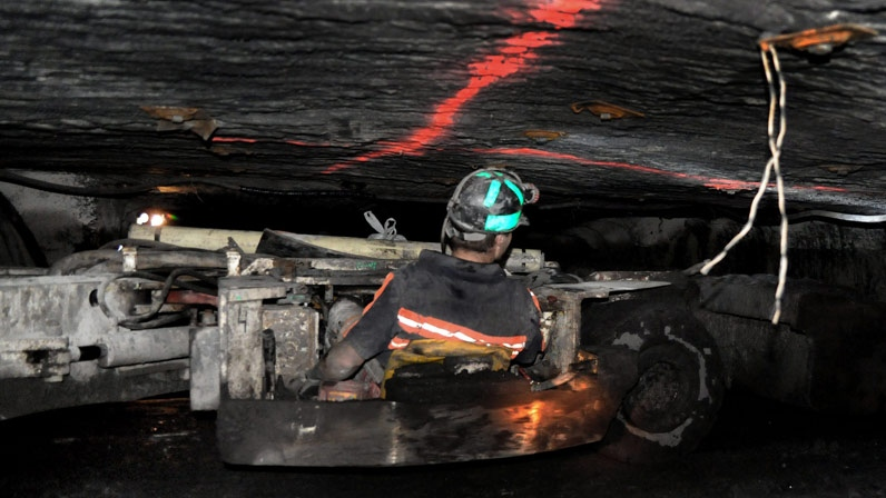 A coal miner drives a scoop while working in a mine in this file photo. (Bristol Herald Courier, David Crigger)