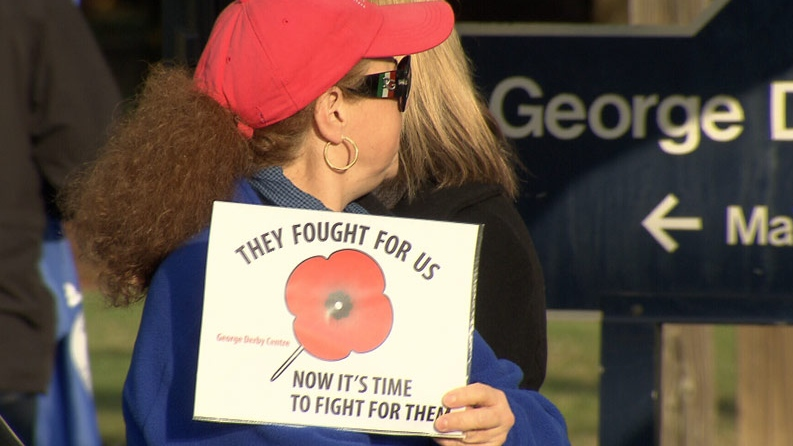 People gathered to rally against layoffs at the George Derby Centre in Burnaby on Saturday. November 22, 2012. (CTV)