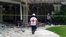 Mexican Red Cross rescuers check a damaged area of the Grand Riviera Princess Hotel in Playa del Carmen, Quintana Roo state, Mexico, Sunday Nov. 14, 2010. A powerful explosion believed to have been caused by an accumulation of gas killed six people, including four Canadian tourists, and injured 15, according to Quintana Roo state Attorney General Francisco Alor. (AP Photo)