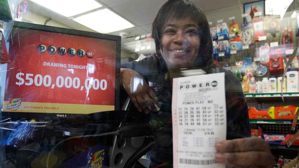 Yvette Gavin, 51, sells dreams in the form of Powerball tickets at a BP gas station in Calumet Park, Ill., on Wednesday, Nov. 28, 2012. (AP / M. Spencer Green)