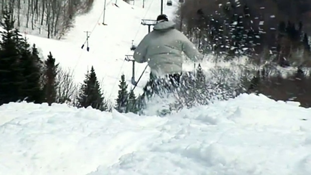 Man goes skiing down a hill