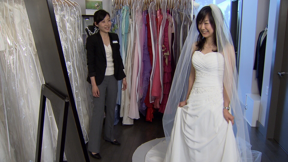 Japanese pediatrician Junko Yamanaka tries on a rental bridal gown in Richmond, B.C. (CTV)