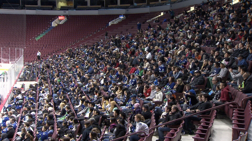 Canucks fans crowd the stands for free at the first day of training camp for the team following the lockout. (CTV)