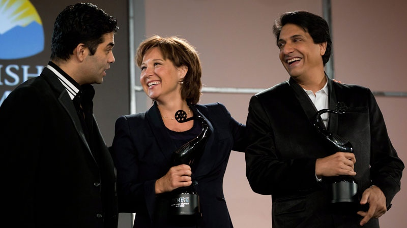 British Columbia Premier Christy Clark, centre, stands with Indian film director Karan Johar, left, and Indian dance choreographer Shiamak Davar in Vancouver, B.C., on Tuesday January 22, 2013. (THE CANADIAN PRESS/Darryl Dyck)