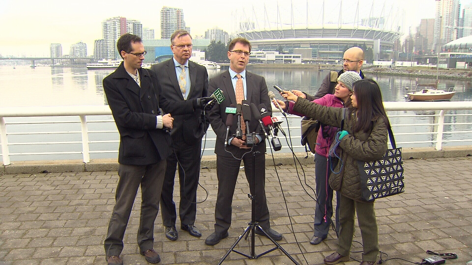 Opposition NDP Leader Adrian Dix, centre, speaks to reporters about taxpayer-funded partisan ads. Jan. 22, 2013. (CTV)