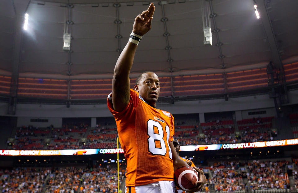 B.C. Lions' wide receiver Geroy Simon celebrates after catching a pass to become the CFL's all-time leader for pass reception yards in this June 2012 file photo. (Darryl Dyck/THE CANADIAN PRESS)