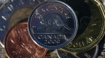 A Canadian nickel is pictured in Ottawa on Monday, January 2, 2013. (Sean Kilpatrick / THE CANADIAN PRESS)