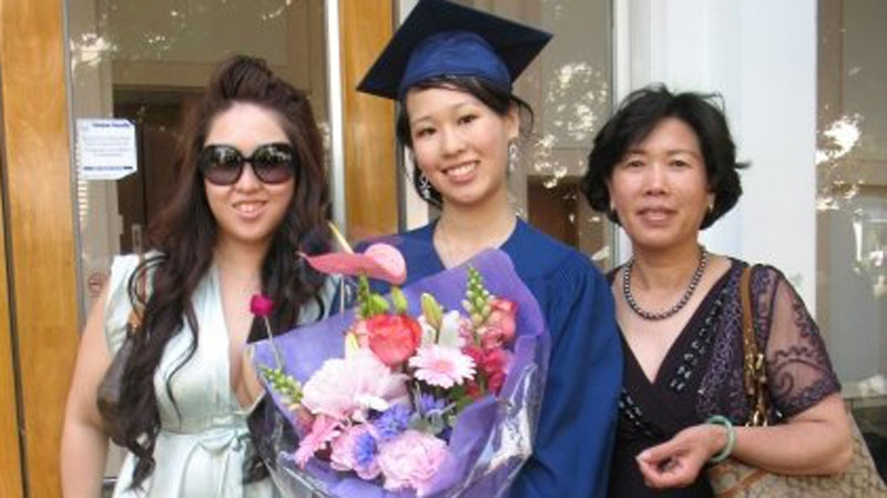 Elisa Lam, middle, posed with her sister and mother in this Facebook image. LAPD say the body of a woman found wedged in a water tank on the roof of a downtown hotel is that of the missing Canadian guest.