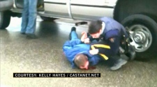 A Kelowna RCMP officer is under investigation after he was caught on video apparently kicking a suspect in the face. Jan. 7, 2011. (CTV)