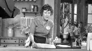 Television cooking personality Julia Child prepares a French delicacy in her cooking studio on Nov. 24, 1970. (AP Photo)