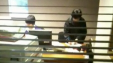 Exclusive video shot yesterday and obtained by CTV News shows Vancouver Kensington MLA Mable Elmore attaching $10 bills to membership forms -- in what may be a violation of the rules. Jan. 19, 2010. (CTV)
