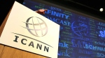 The logo of the Internet Corporation for Assigned Names and Numbers, ICANN, is shown during a presentation in this June 2012 file photo. (AP Photo/Tim Hales)