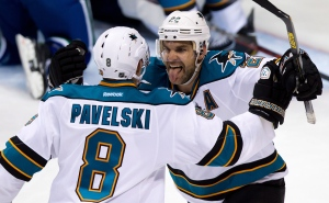 San Jose Sharks' Dan Boyle, right, celebrates his goal against the Vancouver Canucks with teammate Joe Pavelski during the third period in Game 1 of an NHL Western Conference quarter-final playoff hockey series in Vancouver, B.C., on Wednesday May 1, 2013. THE CANADIAN PRESS/Darryl Dyck