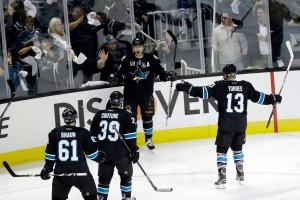 San Jose Sharks center Patrick Marleau (12) celebrates with teammates after scoring against the Vancouver Canucks during the third period of Game 3 of their first-round NHL hockey Stanley Cup playoff series in San Jose, Calif., Sunday, May 5, 2013. (AP Photo/Marcio Jose Sanchez)