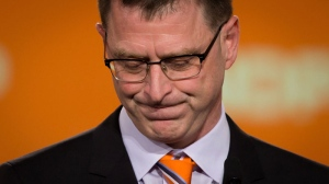 B.C. NDP Leader Adrian Dix pauses while addressing supporters after the Liberal Party was projected to win a majority government in Vancouver, B.C., on Tuesday May 14, 2013. THE CANADIAN PRESS/Darryl Dyck