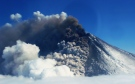 The Pavlof volcano erupts Thursday, May 16, 2013, as seen from the air from the southwest in Cold Bay, Alaska. (Alaskan Volcano Observatory, Theo Chesley)