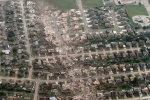This aerial photo shows the remains of homes hit by a massive tornado in Moore, Okla., Monday May 20, 2013. (AP / Steve Gooch)