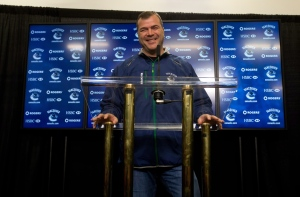 Canucks head coach Alain Vigneault was fired Wednesday after his team was swept by the San Jose Sharks in the first round of the Stanley Cup Playoffs. Vigneault led the Canucks to six division titles and two Presidents' Trophy titles in seven years He also had the highest win total of any Canucks coach. Vigneault holds a news conference during the first day of the NHL hockey team's training camp in Vancouver on Sunday, January 13, 2013. (THE CANADIAN PRESS/Darryl Dyck)