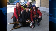 North Shore Rescue members pose with Hurley after they rescued him from a mountainous area in North Vancouver, B.C., on April 7, 2011. (CTV)