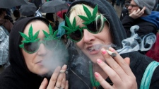 Brenna Richardson and Sam Buchan, right, of Surrey, B.C. smoke marijuana outside the Vancouver Art Gallery in downtown Vancouver, Tuesday, April 20, 2010. The event is to promote the use of marijuana in Canada. THE CANADIAN PRESS/Jonathan Hayward