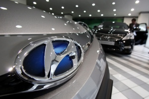 The logo of Hyundai Motor Co is seen on a car displayed at the South Korean automaker's showroom in Seoul, South Korea, Thursday, Jan. 24, 2013. (AP / Ahn Young-joon)