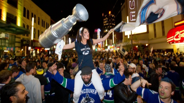 People pack Granville Street in celebration after the Vancouver Canucks advanced to the NHL's Stanley Cup Final after defeating the San Jose Sharks 4-1 in Vancouver, B.C., on Tuesday, May 24, 2011. (Darryl Dyck  / THE CANADIAN PRESS)
