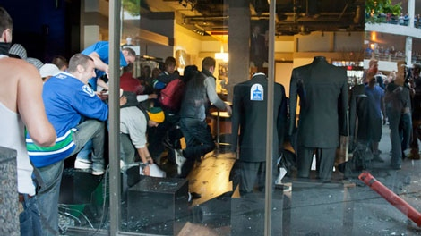People break into the Black & Lee tuxedo shop in downtown Vancouver during the Stanley Cup riots. June 15, 2011. (Janessa Kucey/special to ctvbc.ca)