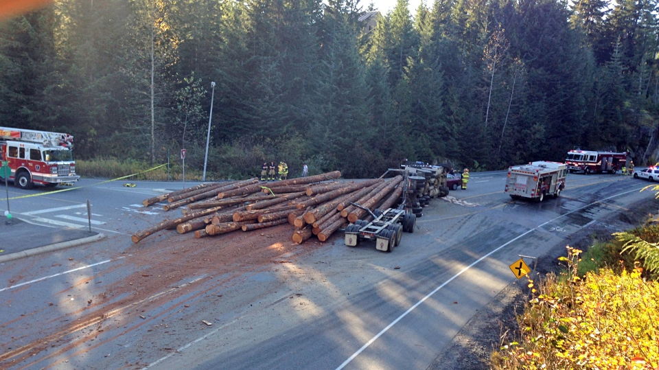 Police say a motorcyclist has died after being struck by logs that spilled from a truck on the Sea-to-Sky Highway, Sat. Oct. 19, 2013.