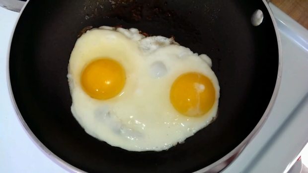 A 35-year-old man has been arrested after being found in a kitchen, naked and cooking eggs.