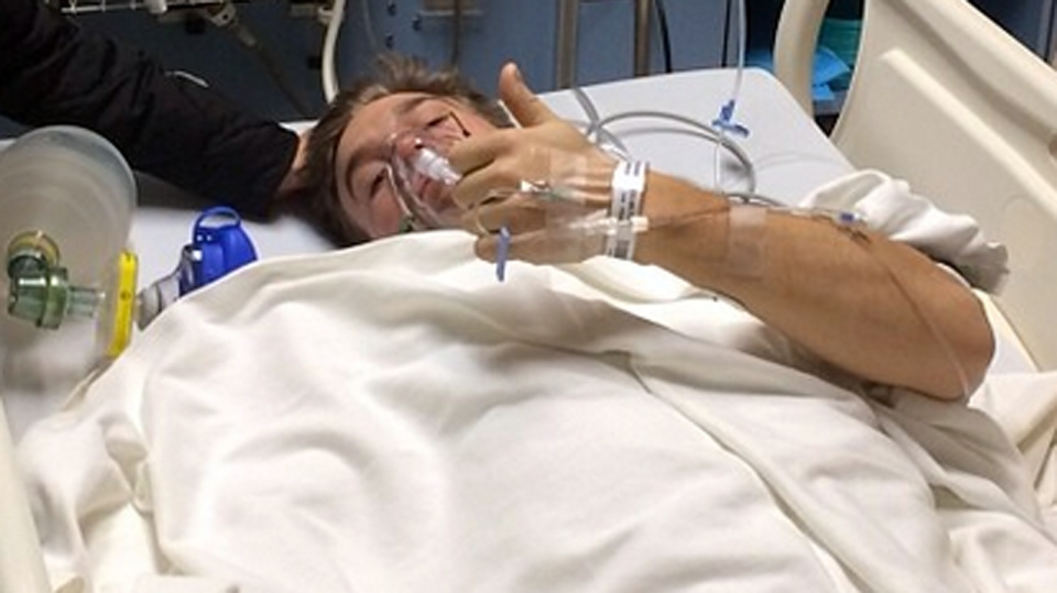 Professional motocross rider Bruce Cook gives a thumbs up from a hospital bed in Ontario after he was seriously injured following a horrific crash Friday night. Jan. 5, 2014. (Instragram/@BruceCookFmx)