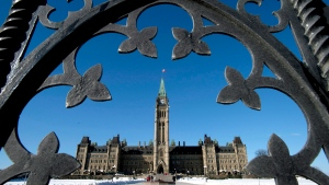 Centre Block is shown through the gates of Parliament Hill on Tuesday, Feb. 11, 2014. (Justin Tang / THE CANADIAN PRESS)
