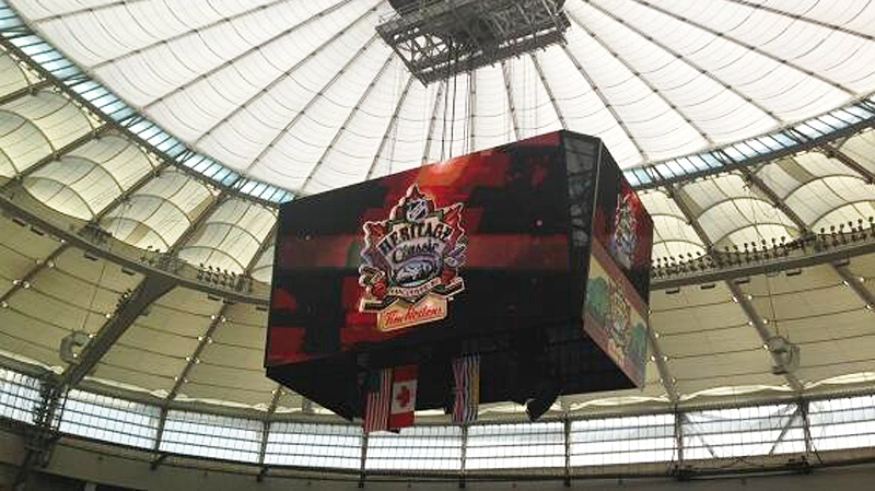 A scoreboard is shown at BC Place in Vancouver as crews prepare for the NHL Heritage Classic which takes place at 1 p.m. Sunday. Feb. 26, 2014. (CTV)