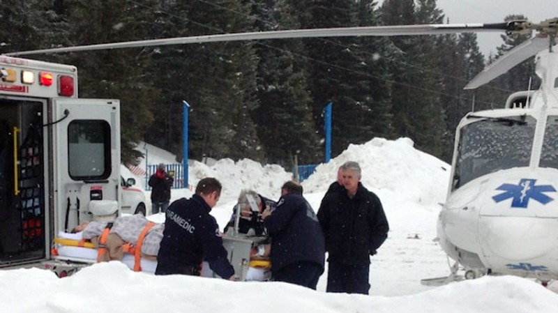 A person is transported into an ambulance by stretcher following a chairlift incident at Crystal Mountain Ski Resort near West Kelowna. March 1, 2014. (Photo courtesy Castanet.net)