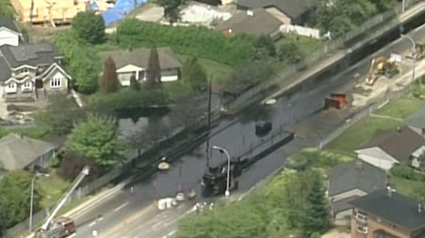 Oil gushes from a punctured pipeline in Burnaby during a 2007 construction project. (CTV)