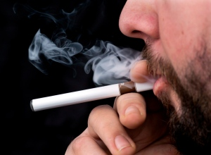 A smoker puffs on an electronic cigarette in Halifax on Friday, Feb. 7, 2014. (Andrew Vaughan / THE CANADIAN PRESS)