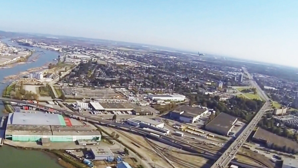 An unmanned aerial vehicle is seen flying close to an airplane above Vancouver International airport in this image taken from a video posted on YouTube, Nov. 4, 2013.