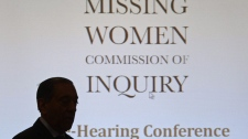 Commissioner Wally Oppal is silhouetted as he arrives for the Missing Women Commission of Inquiry public forum in Vancouver, B.C., on Wednesday January 19, 2011. THE CANADIAN PRESS/Darryl Dyck