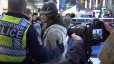 An Occupy Vancouver protester is detained by police. Nov. 18, 2011. (CTV)
