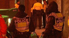 Police move on the Occupy Victoria encampment before dawn on Tuesday, Nov. 22, 2011. (CTV)