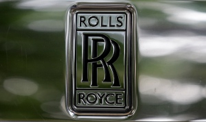 The emblem on the front of a Rolls-Royce car is seen in a show room in London on Tuesday, July 8, 2014. (AP / Kirsty Wigglesworth)