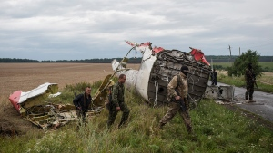 Pro-Russian fighters at the crash site of a Malaysia Airlines passenger jet near the village of Hrabove, Ukraine, Friday, July 18, 2014. (AP / Evgeniy Maloletka)