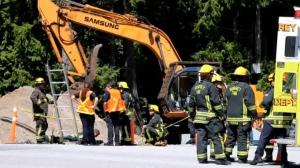 A man working on a sewer trench had to be rescued by firefighters after the trench he was working in collapsed, burying him waist-deep in debris. July 29, 2014. (CTV)
