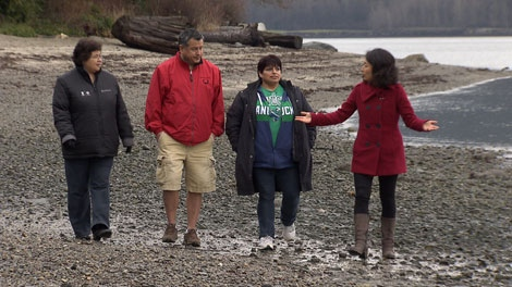 CTV investigative reporter Mi-Jung Lee walks the shore of the Tsleil-Waututh reserve with a trio of elders. Jan. 10, 2012. (CTV)