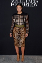 Kim Kardashian poses as she arrives to attend a Vogue party in Paris on July 9, 2014. (AP/Thibault Camus)