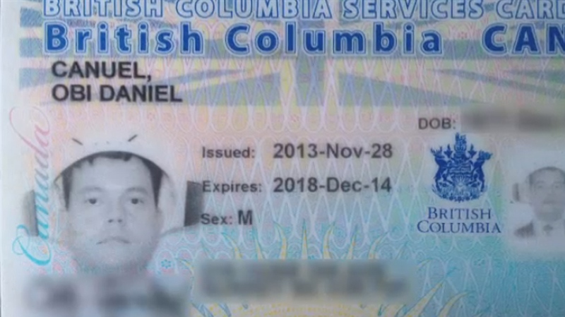 Obi Canuel is shown wearing a colander on his head for his B.C. Services ID photo.