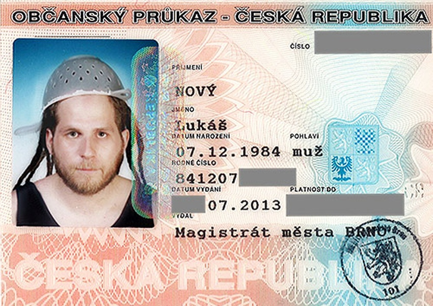 Czeck republic guy wears a colander on his head for driver's license photo.